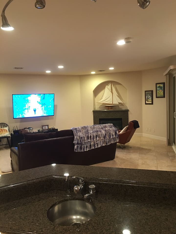 """Modern space with 10' ceilings and 70"""" smart LG tv"""