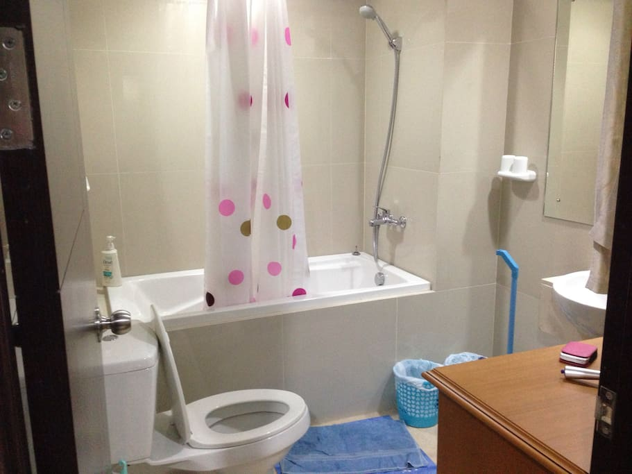Next to the main bedroom is a bathroom with bathtub, shower, and water heater. Curtain is also available to keep the bathroom dry