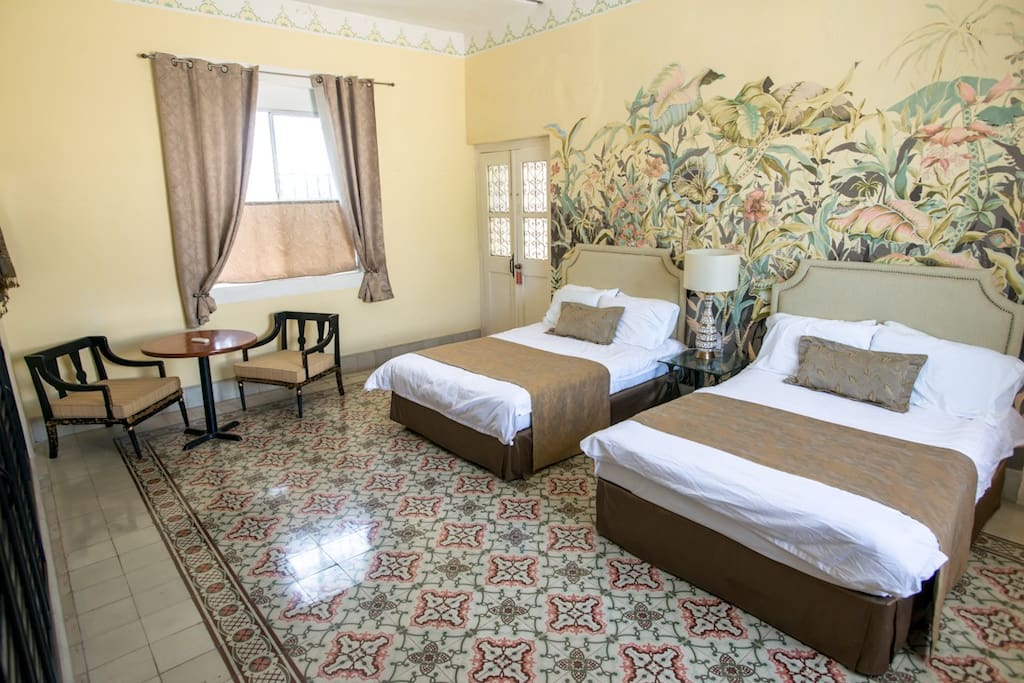 Lovely large room with 2 double beds.