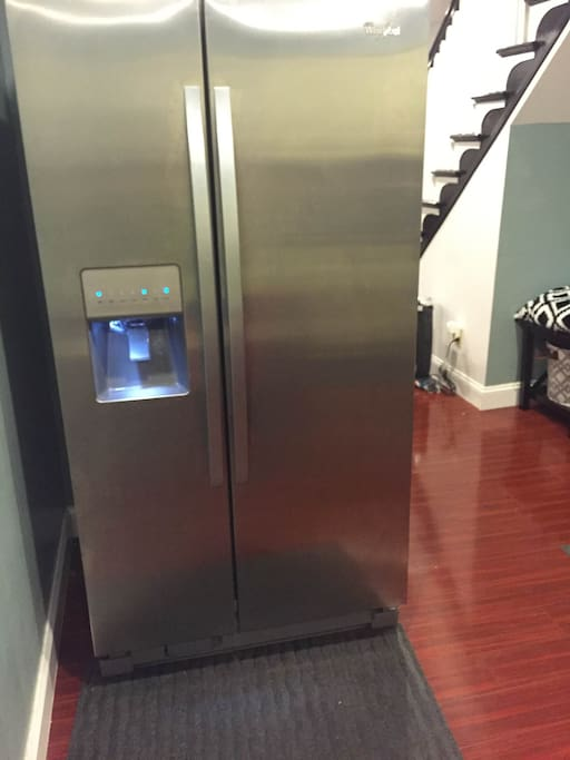 Refrigerator with ice maker and water dispenser.