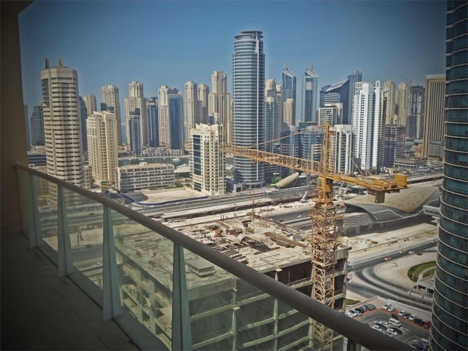 View from the Balcony (Metro station below, Dubai Marina/JBR across the highway)