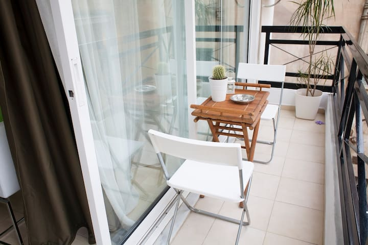 Balcony with external table for coffee break .