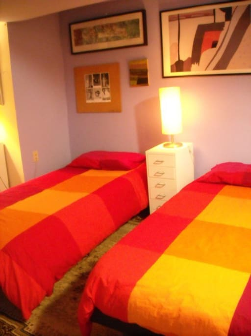 Two single beds, can be merged as one large bed if you're a couple.