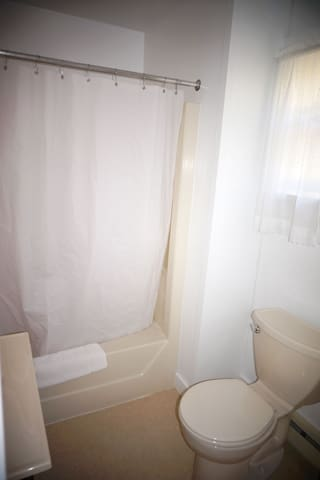 simple clean private bath with fluffy towels, soap and shampoo provided