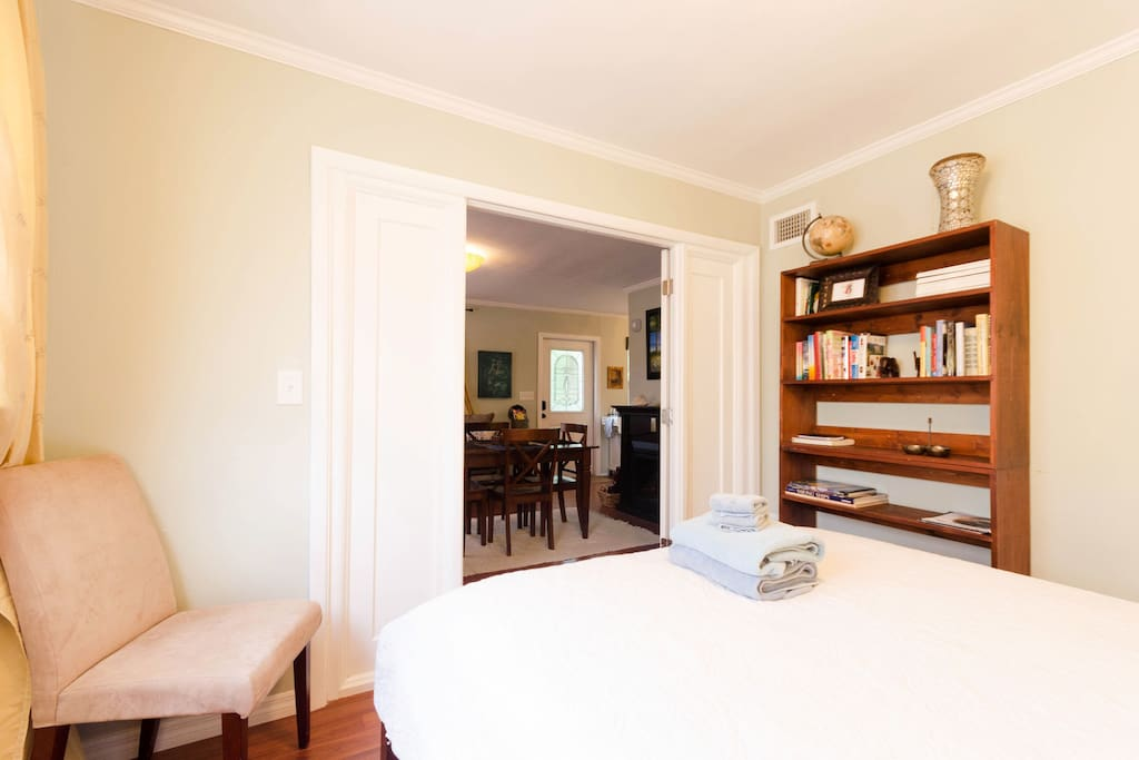 Master bedroom with French doors and queen sized bed