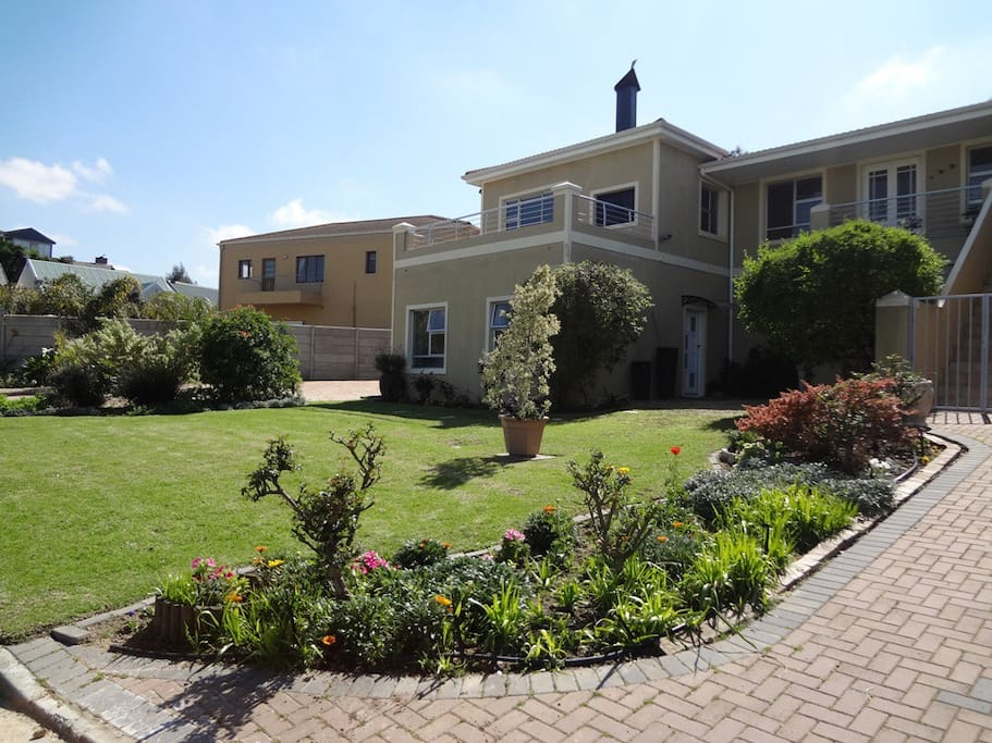 Front garden with the flat entrance area on the right side ground floor.