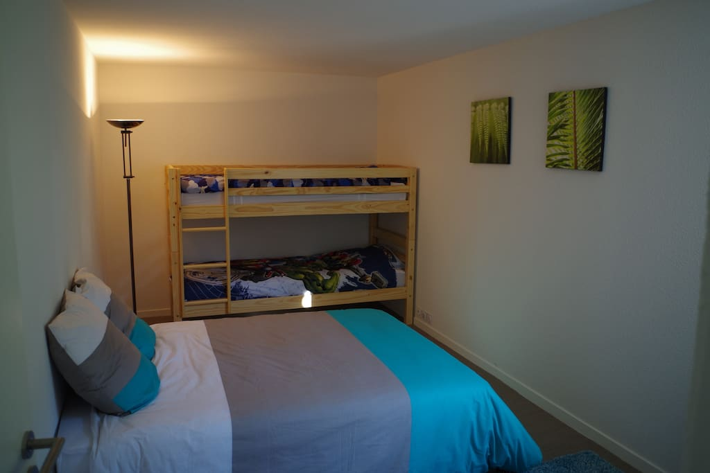 Very spacious separate family bedroom with double bed, 2 large bunks and plenty of storage