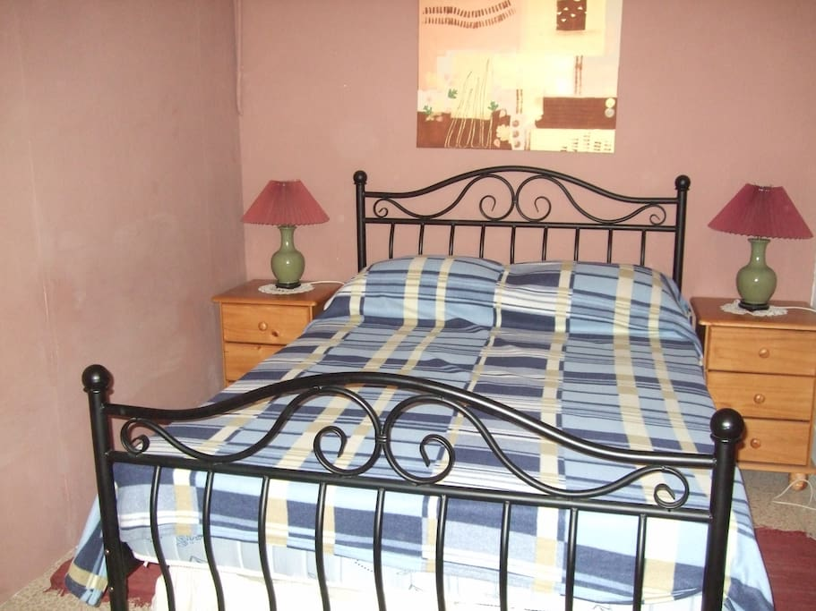 Double bed room with a big window. Also has a desk and chair.