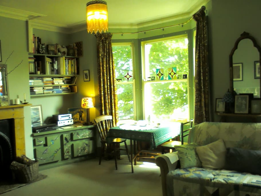 Living room:  Big sunny room with two sofas (one a sofa bed), arm chair, dining table and piano (feel free to  tinkle!)  Also very private as there's a beautiful big Elm tree just outside the window.