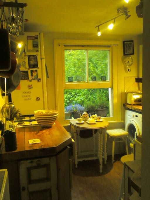 My lovely kitchen.  The previous owner was a carpenter and he made this lovely wooden kitchen!  There's also a great view out of the window - I spend a lot of time drinking tea and looking out of this window!