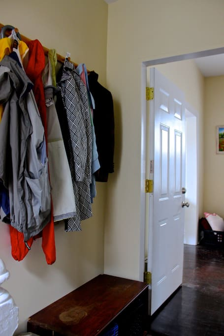 Doorway with space to hang coats and leave shoes.