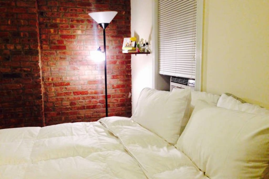Bedroom with exposed brick.