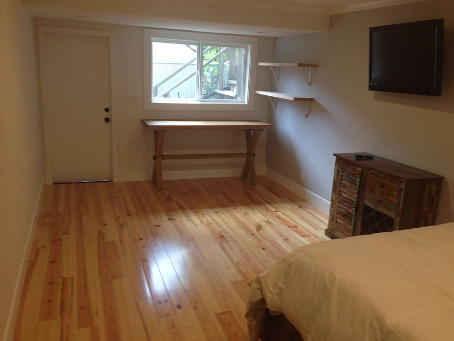 This view shows the separate entrance & exit to unit as well as breakfast area.