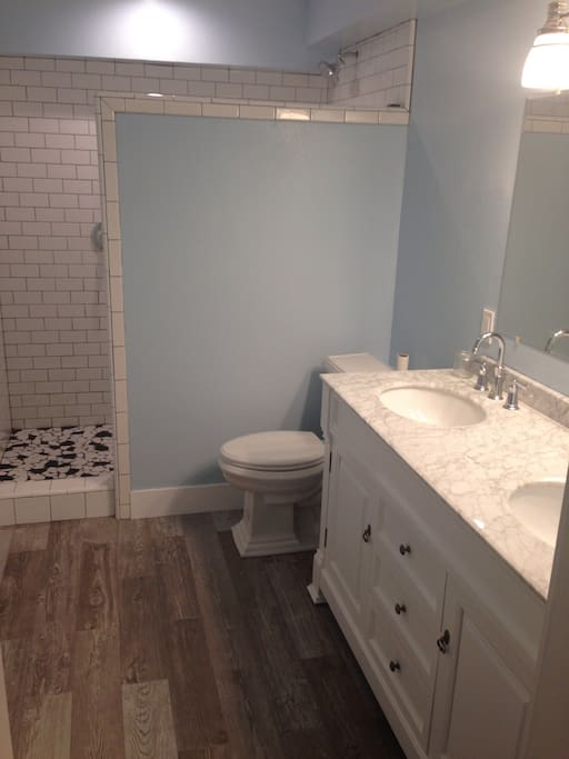 This shows the huge walk-in shower with a 7 foot shower head.  Also, there is a gorgeous vanity with double sinks & marble countertop.