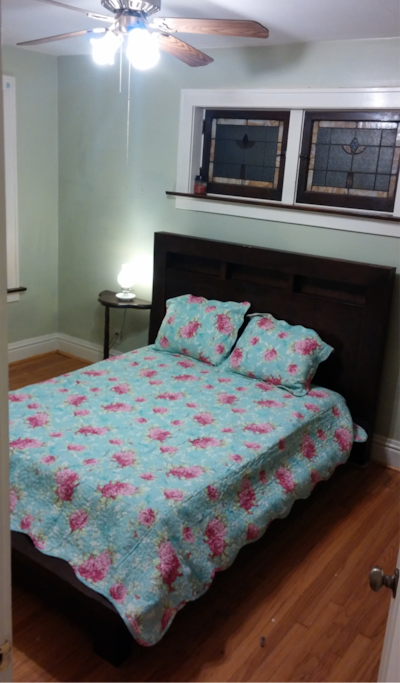 Bedroom with queen bed.  This bedroom also has an empty closet and shelves for your use.