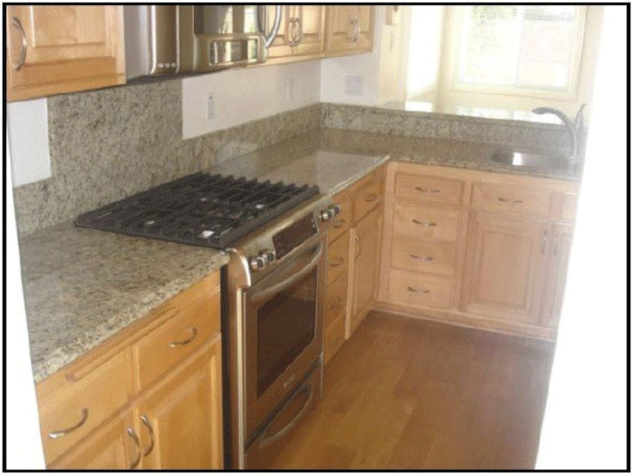 Granite countertops in Kitchen. Stainless Steel KitchenAid Appliances.