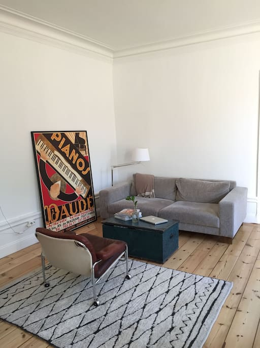 Parisian poster and antique leather chair