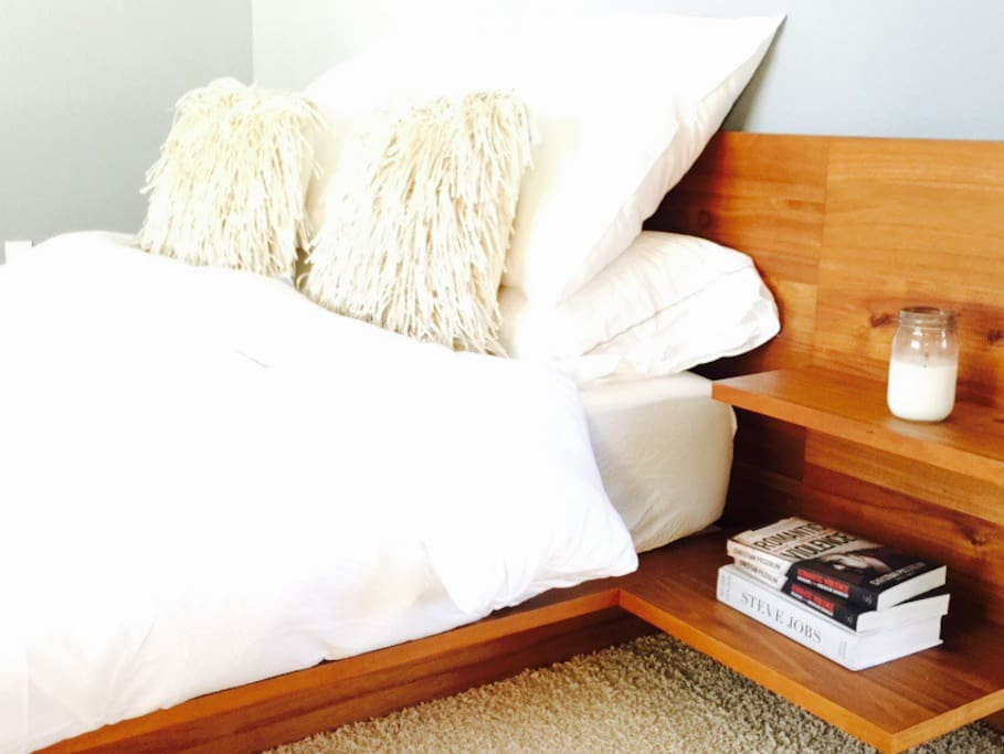 Premium suite has Egyptian cotton linens and elegant walnut bed frame with Casper mattress.