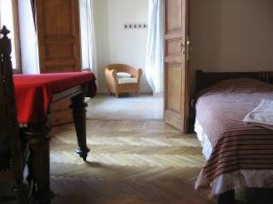 Burgundy Room: a large room with an extremely wide double bed, divan/bed, and huge bathroom