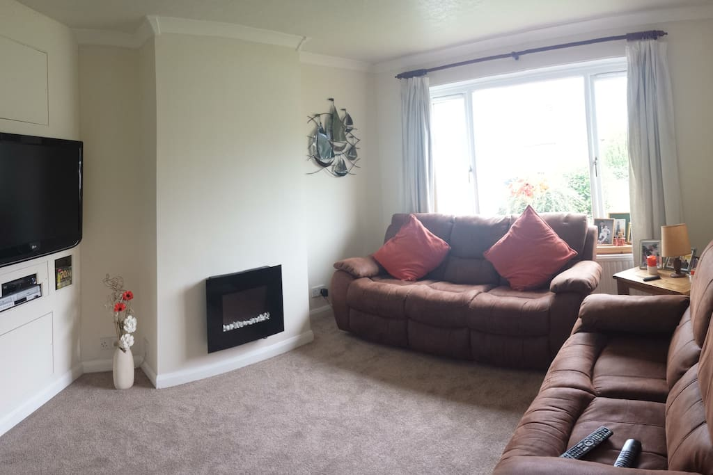 Bright sitting room with recliner settees , WiFi and sky sports TV.