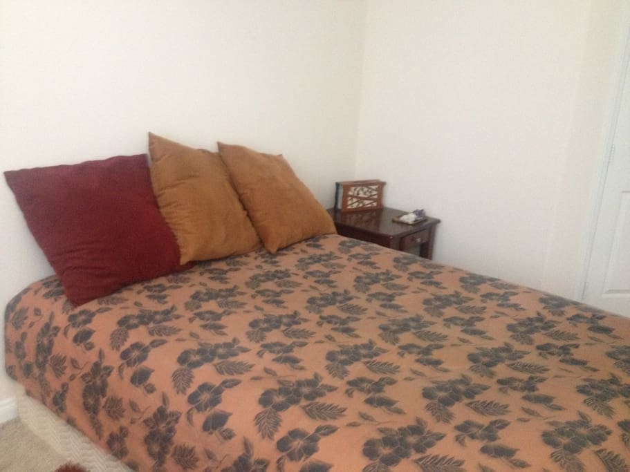 the hawaiian print bed spread that is accented by some beautiful crystals and a mellow night light