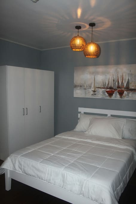 The bedroom is furnished with a 3-door cabinet with ample storage.