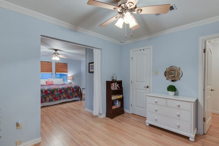 This large bonus room is attached to the master bedroom and has twin bunk beds.  Half bathroom also.