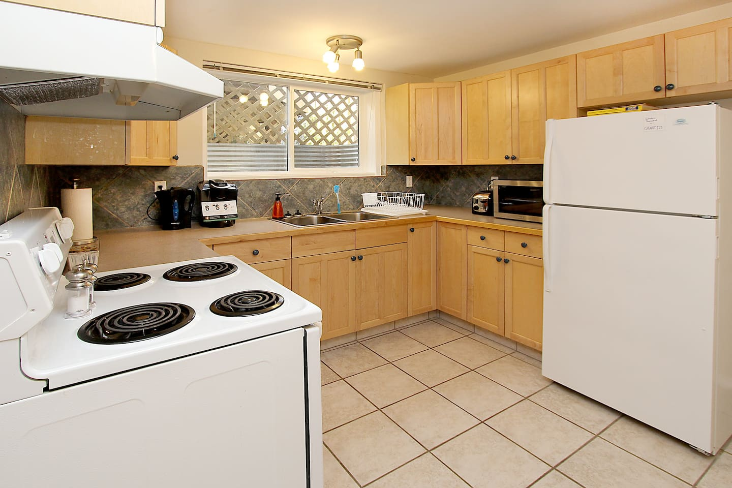 Kitchen with amenities such as coffee/tea, stove, fridge &  microwave.