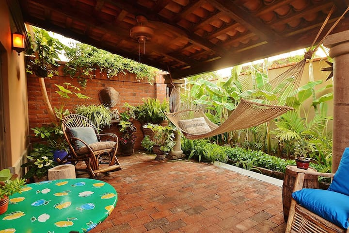 Private tile covered patio... A relaxing Hammock awaits you.