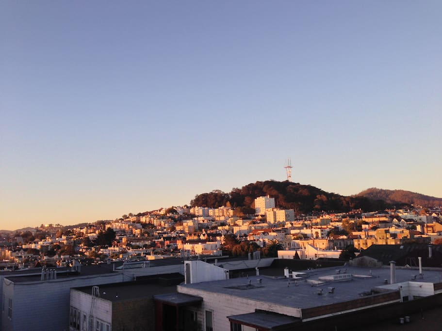 View of Twin Peaks from bedroom window at sunrise