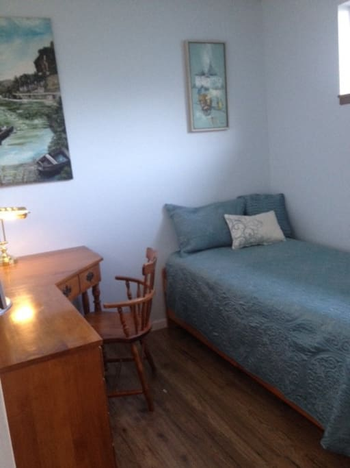 Blue room bed photo.  Room also has large mirrored closet in it and bathroom next door.