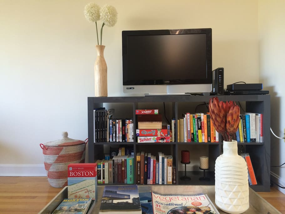A bunch of Boston guides waiting for you on the coffee table, and also some vegetarian cooking inspiration! Games like Monopoly and Scrabble and different books on TV stand to keep you happily busy :)