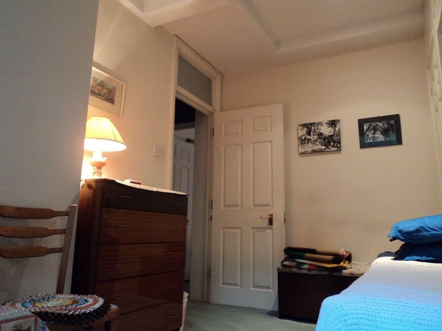 A warm and welcoming room with single bed and all amenities