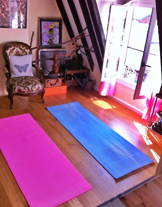 Our lovely bright living room - big enough for a little yoga! Mats available for use.