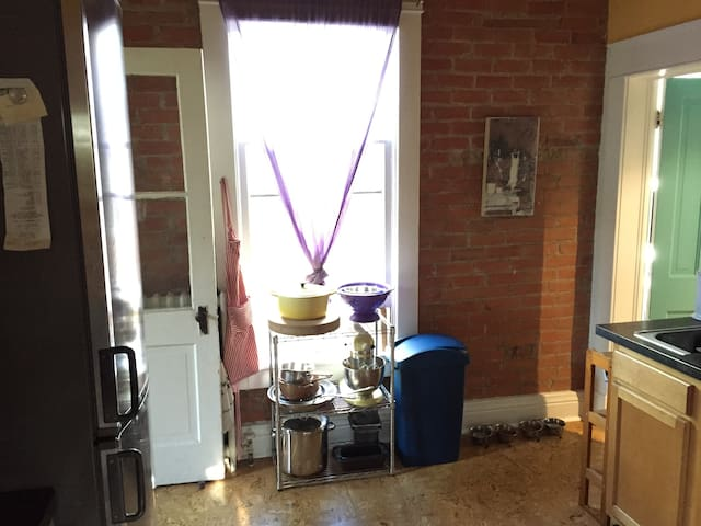 Bright colored kitchen space.