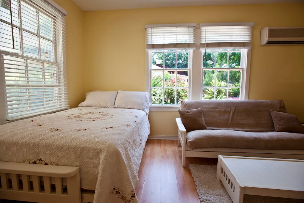 Your sunny, furnished studio with high ceilings, A/C, heating, cable & internet, numerous windows, and wood floor