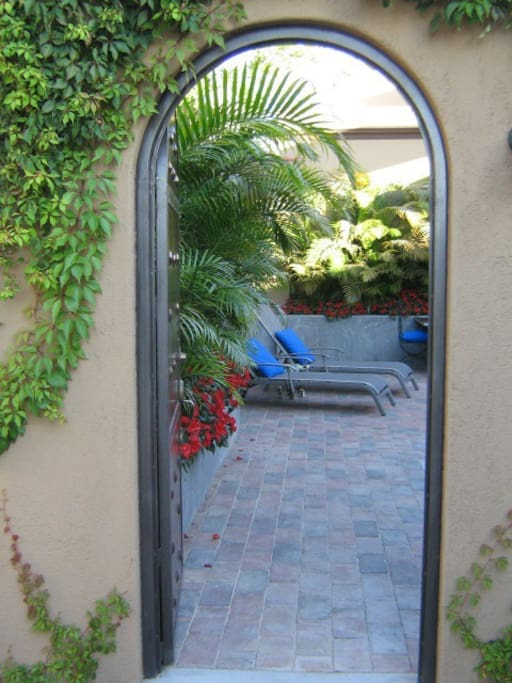Doorway to the private guest deck and pool lounge area.