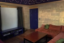Home theater with dimmable whole-ceiling lighting.