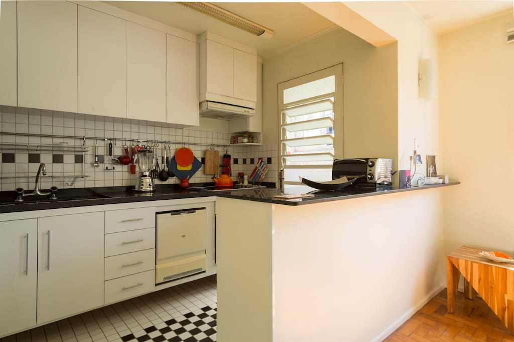 fully funirtured and equipped kitchen with natural light during the whole day