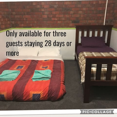 One single bed can be swapped for a queen mattress on the floor to accommodate three guests when staying for 28 days or more. Please ask before booking.