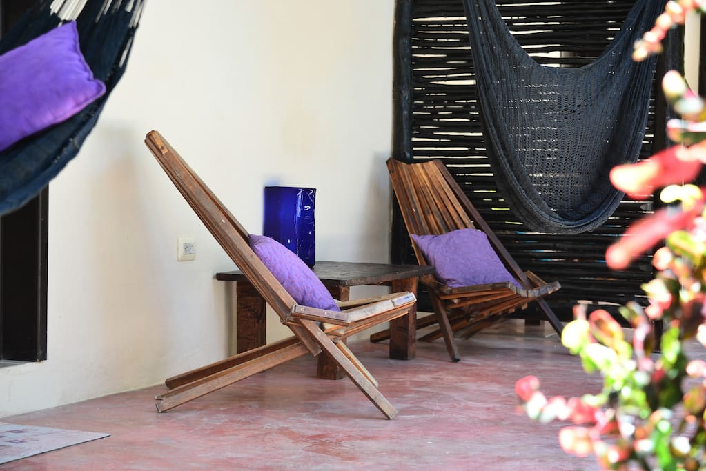 Your own private patio with chairs and hammock in our tropical garden. A good place to read a book and enjoy you morning coffee.