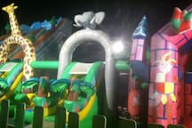 Inflatable castles for the children to play on while you enjoy a beverage by the sea.