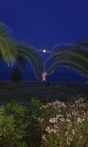 Watch the moon rise over the Aegean Sea.