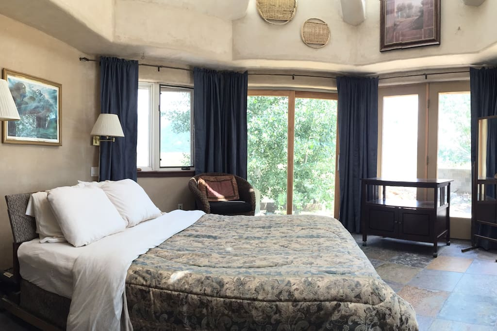 Our spacious octagon sunroom is furnished with a queen sized bed.