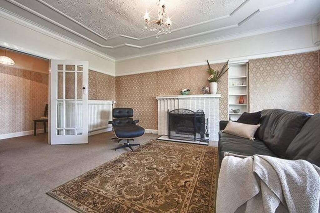 Original fireplace & ornate ceilings