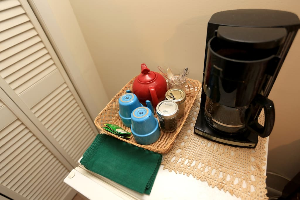 There is coffee-maker, a microwave  and small fridge.