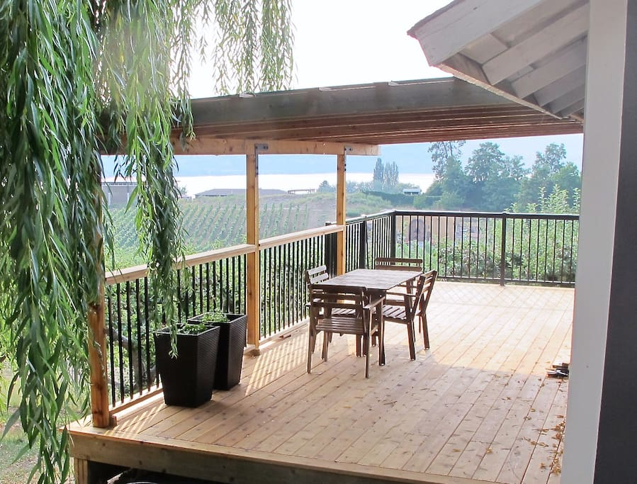 Covered Deck with  View of the Vineyards and Lake