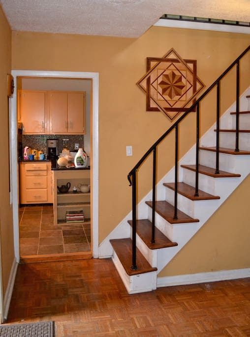 Stairway guides you up to your 2nd floor Retro Blue bedroom and another common guest area.