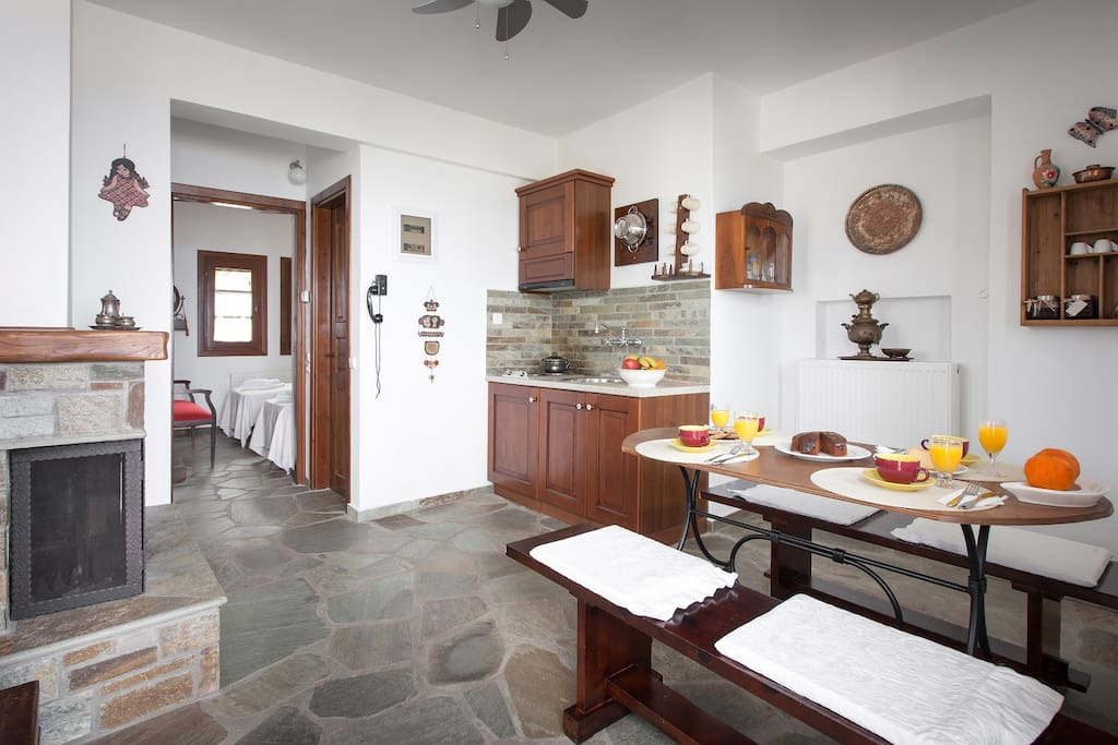 Kitchen and living room. Floor with traditional Pelion stone.