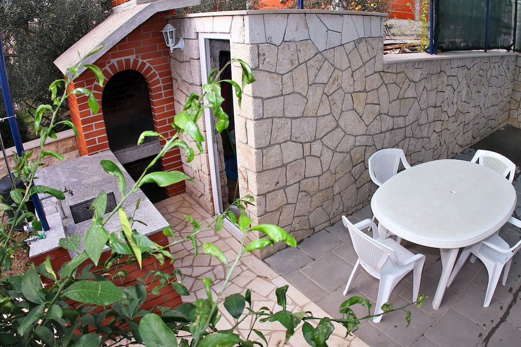 Outdoor fireplace with terrace for more families